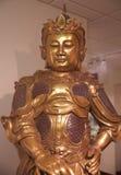 Busto de un monje chino del guerrero en un museo Imagen de archivo