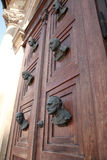 Busts on the door of Mariacki door Stock Images
