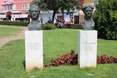 Busts Pino Budicin and Matteo Benussi Cio, Rovinj. Busts of Pino Budicin and Matteo Benussi Cio, war heros and communist activists, on plinths in a park in royalty free stock images