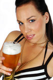 Busty brunette with a pint. Sexy busty brunette isolated on white with a pint of beer Royalty Free Stock Photo