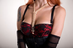 Busty redhead woman in vintage red bra Royalty Free Stock Photography
