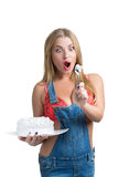 Busty sexy girl eating cake with whipped cream Royalty Free Stock Photos