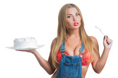 Busty sexy girl eating cake with whipped cream Stock Photo