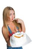 Busty sexy girl eating cake with whipped cream Royalty Free Stock Image