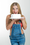 Busty sexy girl eating cake with whipped cream Royalty Free Stock Photography