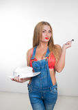 Busty sexy girl eating cake with whipped cream Stock Image