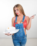 Busty sexy girl eating cake with whipped cream Stock Images
