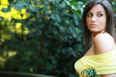 Busty spring girl. Busty cleavage young female girl or woman in spring on or in front of a nice summer green grass meadow with a shirt and braless Royalty Free Stock Images