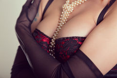 Busty woman in vintage red bra Royalty Free Stock Photo