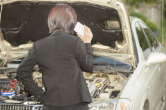 Busuness woman with her broken car, calling for assistance Royalty Free Stock Images