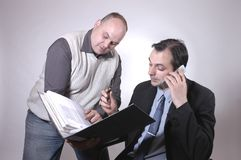 Busy. Portrait of  two businessmen Royalty Free Stock Photo