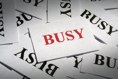 BUSY. Many pieces of paper with special text on it Royalty Free Stock Photo