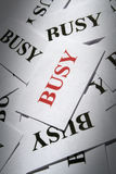 BUSY. Many pieces of paper with special text on it Royalty Free Stock Image