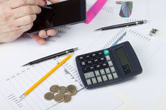 Busy accountant at work using his smart phone Royalty Free Stock Photo