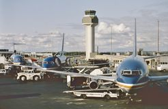 A busy afternoon at the Wien Air Alaska ramp at Anchorage International Airport, Alaska on September 1, 1980. 2 Boeing B-737 and a Boeing B-727 royalty free stock photography