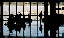 Busy airport. Business people at the airport Royalty Free Stock Images
