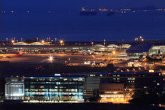 Busy airport at night Stock Photo