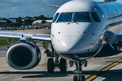 Busy airport tarmac traffic before airplanes take off. Busy airport tarmac traffic before airplanes  take off royalty free stock photos