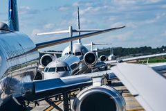 Busy airport tarmac traffic before airplanes take off. Busy airport tarmac traffic before  airplanes take off royalty free stock image