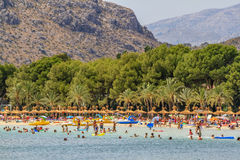Busy Alcudia beach in summer. Crowded main beach of Alcudia in mid summer. A very popular beach for families because of the soft white sand and the  shallow Royalty Free Stock Images