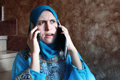 Busy arab muslim businesswoman with tablet and mobile Royalty Free Stock Photos