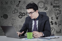 Busy Arabian worker using laptop to work royalty free stock images