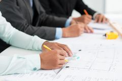Busy architects Stock Photo