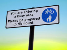 Busy area dismount sign Stock Photo