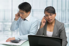 Busy Asian business people on the phone Stock Photo
