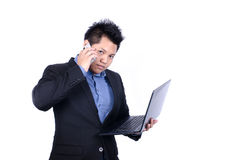 Busy Asian businessman talking smart phone Stock Photo