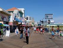 Busy Atlantic City Boardwalk With Crowds of People. Crowds of people walking on busy Atlantic City boardwalk in August, 2018 stock image