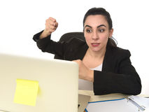 Busy attractive woman in business suit working in stress desperate overwhelmed Stock Photos