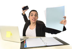 Busy attractive woman in business suit working in stress desperate overwhelmed Stock Images