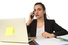Busy attractive woman in business suit working in stress desperate overwhelmed Royalty Free Stock Photo