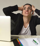 Busy attractive woman in business suit working in stress screaming desperate overwhelmed Stock Photography