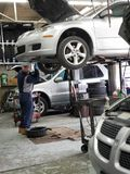 Mechanic doing oil change royalty free stock images