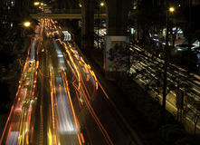 Busy Bangkok Street. Traffic on a busy Bangkok street at night. Lone exposure to show motion blur of car lights Royalty Free Stock Image