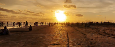 Busy beach at sunset in Jave Royalty Free Stock Photo