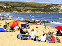 Busy beach at Swanage, Dorset, UK. Busy beach on a September day at Swanage, Dorset, England, UK Stock Photo
