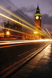 Busy big ben. Big ben at rush hour traffic, in London, England, United Kingdom with traffic passing though the shot royalty free stock images