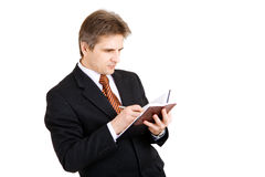 Busy bisnessman writing stock photography