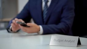 Busy budget analyst using smartphone, scrolling websites and zooming files. Stock photo royalty free stock image