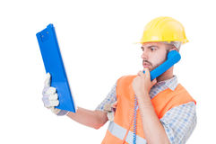 Busy builder using phone on white copy space Stock Photography