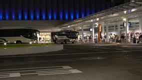 Busy bus stops at Shinjuku Expressway Bus terminal or Busta Shinjuku in Tokyo, Japan, at midnight. Tokyo,Japan-July 29, 2019: Busy bus stops at Shinjuku stock video footage