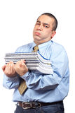 Busy business man. Carrying stacked files over a white background Stock Image