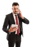 Busy business man multitasking Royalty Free Stock Image