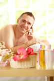 Busy business man in spa salon Royalty Free Stock Photo