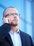 Busy business man talking on cellphone Royalty Free Stock Image