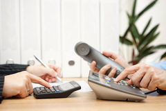 Busy business people analyzing business data and calling custome. Rs Stock Images