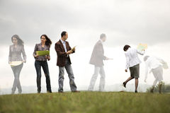 Busy business people outdoors. Business people on a hill organizing and looking for files Stock Photo